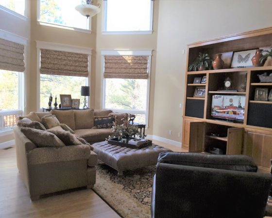 Family room with beige walls and entertainment center