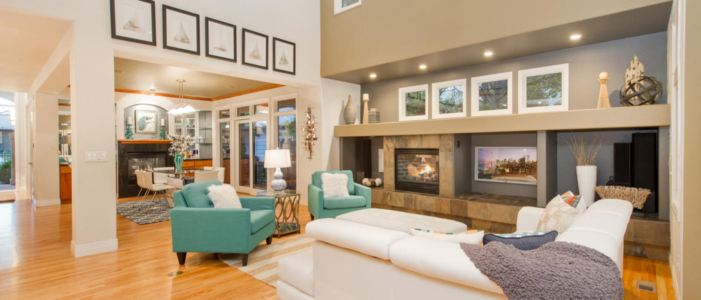 Professional Staging of Large Scale Roms with open floor plan and valuted ceiling