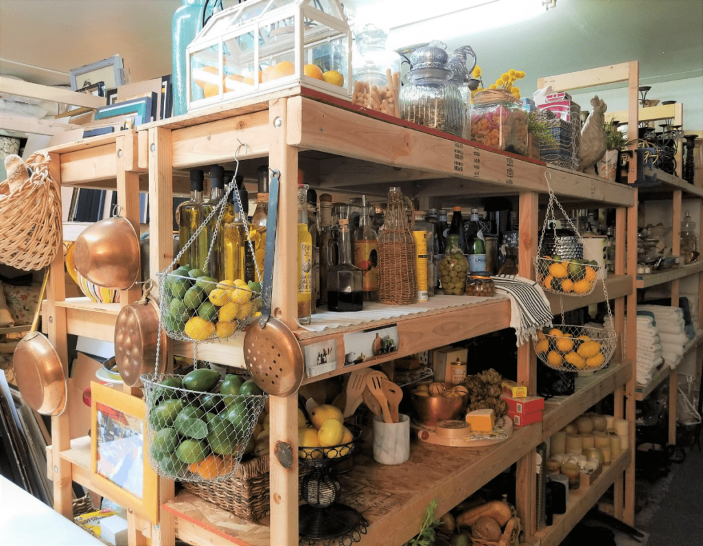 Wooden warehouse shelves filled with kitchen supplies for staging a kitchen